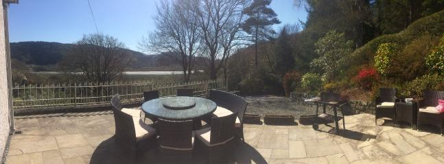 Outdoor dining on the patio with view over Mawddach estuary and valley