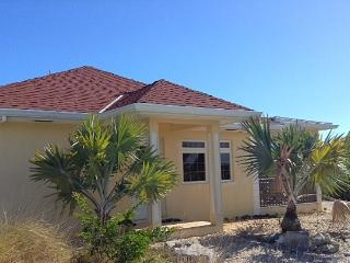 Westview Gardens, 2 bedroom cottage, sunset views, Long Bay Beach