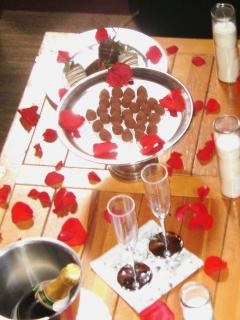 Romance package add on's~red rose petals placed in hot tub, bed, and table $12..Pre-lit candles $10.