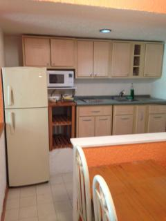 Your fully equipped kitchen & dining area of your 2ND SOLYMAR OCEAN VIEW CONDO! Everything you need!