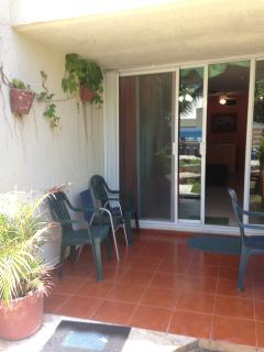The patio of your 1ST SOLYMAR OCEAN VIEW CONDO! An easy 30 sec-1.5 min walk to the pools & beach!