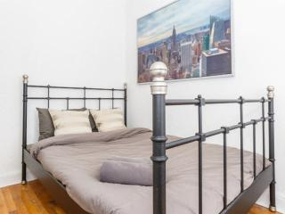 A clean bedroom in Manhattan 8E, New York