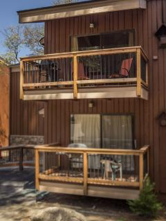 Exterior view.  Your deck is the upstairs unit with the orange chairs.