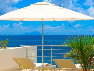 AQUALINA 402 PENTHOUSE... Wow! Fabulous Beachfront condo on Simpson Bay Beach w/ rooftop terrace!