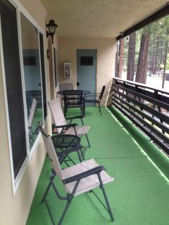 Our upper level unit features a private balcony with plenty of seating.