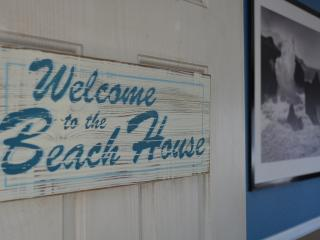 Kick off your shoes and leave your worries at the front door of this Beach Bungalow!