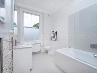 Beautiful 4 bedroom family townhouse very near to Parsons Green with lovely outdoor area