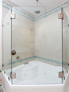 The hall bath also has a combination jetted tub and rainfall shower.
