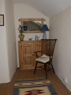 Landing with pine cupboard, artisan mirror and spindle-back chair