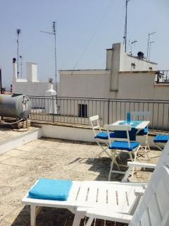 Private sunny roof-terrace with views down to the sea