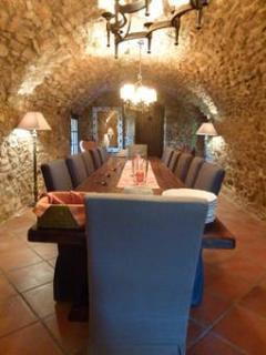 Stone barrel-vaulted dining room provides a unique setting for meals during your stay