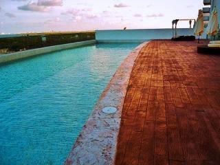 Cancun  furnished 3 Bdr. Apt. at Malecon Americas