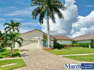 Waterfront house on extra-wide canal, w/ heated pool & hot tub, Marco Island