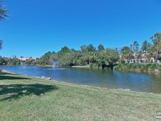 Lake view 2 bedroom top floor condo located in gated resort community, Naples