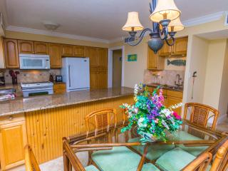 Cooks kitchen, dining table with 6 chairs and wet bar