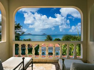 Short walk form Mahoe Beach, this 2- level villa is connected via a covered garden walkway to the guest house. VG BEL, Virgin Gorda