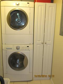 Laundry room.  Washer/dryer, sweeper, miscellaneous cleaning supplies and storage.