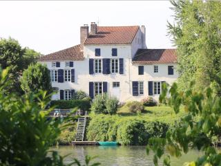 Magnificent cottages on the banks of the river Lot, Clairac