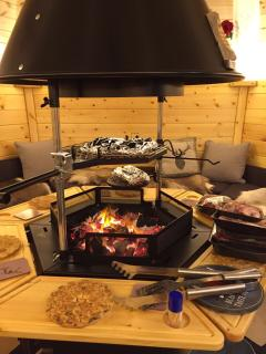 Rustic interior with all the trimmings including reindeer skins, charming lighting-grilling utensils