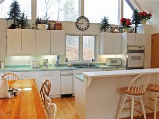 Located at Base of Powderhorn Mtn in the Western Upper Peninsula, Large Home with Spacious White Kitchen & 2 Wood-Burning Fireplaces, Ironwood