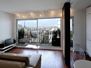 Modern apartment with balcony, view of Paris