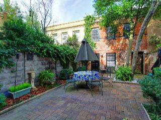 Walk everywhere from this classy and cute carriage house with a beautiful courtyard., Savannah