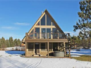 Located at Base of Powderhorn Mtn in the Western Upper Peninsula, A Gorgeous Modern Home with Heated Entryway & Brick Fireplace, Ironwood