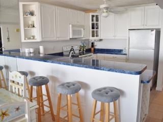 Located at the end of the famous Ocean City boardwalk, this 2 BR 2 BA ocean front condo has it all!