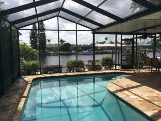 Alluring 3BR New Port Richey Waterfront House w/Private Screened-In Swimming Pool, Dock, & Beach Access!  Over $5k in New Upgrades!