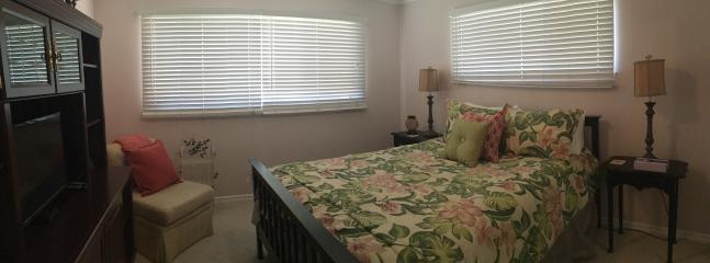 Tropical paradise bedroom offers queen bed, chair, closet, flat screen tv cable wifi, light & bright