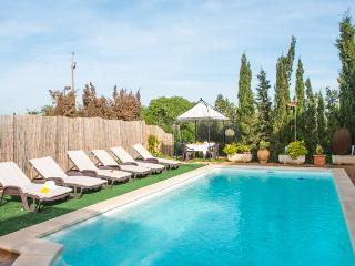 Country house surrounded by cypresses and pool, Porto Cristo