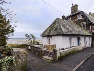 MOORHURST COTTAGE, semi-detached, gas stove, enclosed patio, in Grange-over-Sands, Ref 913753