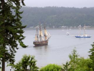 View of tall ships from the deck at Bayview Retreat