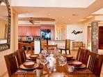 Indoor Dining For Six with View of TV and Kitchen