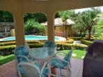 Nice groundfloor condo- near beach, shared pool, cable, gas grill, a/c