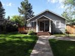 Downtown bungalow with originial art, hot tub and big fenced yard!!