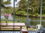 Spinnaker's Screened Porch with pass-through to Kitchen and view of Oyster Bay  and  Assateague  VA