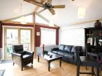 Living room - big flatscreen, surround sound theater, DVDs, vaulted ceiling, comfy leather sleeper