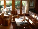 Light filled living room w/Queen size pull out leather couch