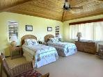 The charming third bedroom has a wonderful ocean view.