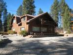 Secluded Payette River Estate home with large yard and private hot tub.