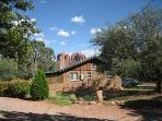 Sedona cabin from road. See Cathedral Rock which looms in full view behind cabin, visible from back!