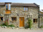 HAYLOFT COTTAGE, pet friendly, character holiday cottage, with a garden in Staintondale, Ref 1210
