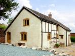 HOLLY COTTAGE, pet friendly, character holiday cottage, with a garden in Lower Wood, Ref 2041