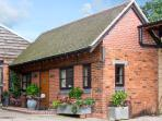 THE DAIRY, romantic, character holiday cottage, with a garden in Leighton, Ref 3700