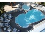 Large heated pool and spa with plenty of seats in and out of the sun