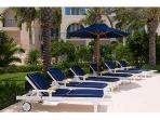 Comfy loungers surround the pool