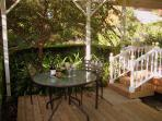 Cottage deck overlooks gardens and estate vineyards. Private & peaceful...