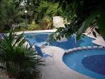 Shared pool & tennis off patio