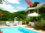 Gingerbread cottage with sunset ocean views and Mt. Nevis with guest cottage. KL FAR
